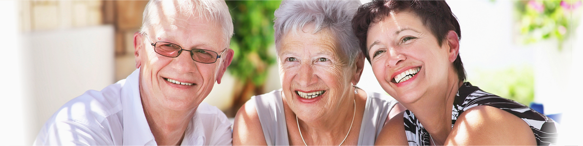 a group of old people smiling at camera