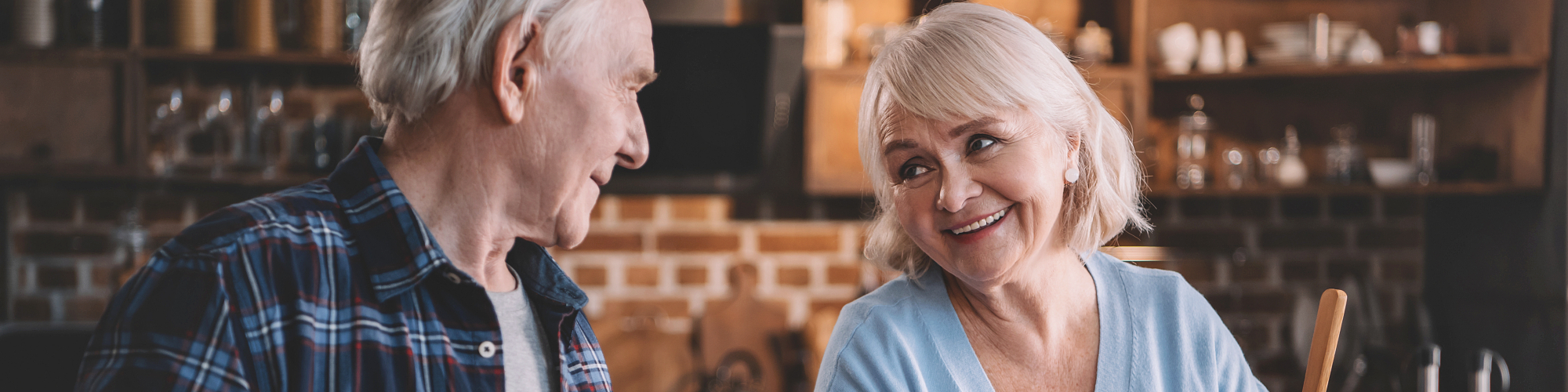 old couple looking each other while smiling